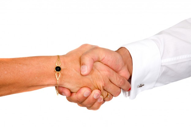business handshake deal over a white background