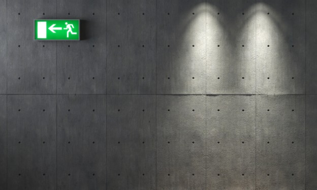 background texture of concrete wall with two spotlights and an emergency exit signal